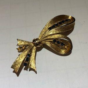 Vintage J.J.  Blue rhinestone Gold bow brooch pin